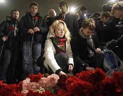 People put flowers at the site of a blast at Moscow's Domodedovo International Airport on Tuesday.
