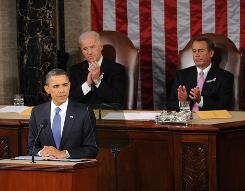 Vice President Biden, left, and House Speaker John Boehner, R-Ohio, clap as President Obama delivers the State of the Union Address Tuesday.