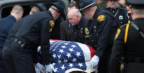 Officers gathered Jan. 14 for the services of slain Rainier Police Chief Ralph Painter in Portland, Ore.