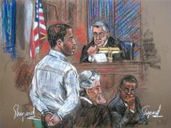 This courtroom drawing shows Ahmed Ghailani, left, in court before U.S. District Judge Lewis Kaplan, top, with his defense attorney Peter Quijano, second left, and an unidentified attorney.
