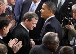 President Obama greets Supreme Court Chief Justice John Roberts at last year's State of the Union Address. Roberts and five other justices will attend Tuesday's speech.
