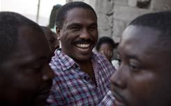 Presidential candidate Jude Celestin, center, smiles during a campaign rally in Port-au-Prince, Haiti, on Jan. 10, 2011.