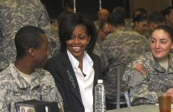 First lady Michelle Obama sits with soldiers in training Rudolph Buchanan of Illinois and Kimberley Welsh of Vancouver, Canada, on Thursday at Fort Jackson in Columbia, S.C.