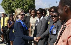 U.S. Secretary of State Hillary Clinton greets embassy staffers as she arrives to Port-au-Prince, Haiti on Sunday.