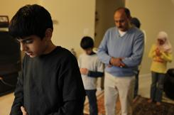 Umaid Qureshi leading an afternoon prayer for family members in their home in Herndon, Va., a suburb of Washington, D.C.