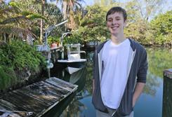 Nicholas Harrington, 16, poses on a dock in his back yard, Thursday, in Miami. Harrington, who said that he was looking to boost his art school application, took a bow Thursday for being the one behind the grand piano that mysteriously showed up on a sandbar in Miami's Biscayne Bay.