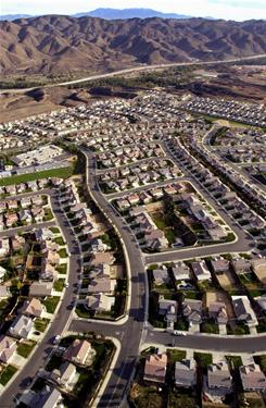 "Suburban sprawl communities like the one here in Corona, Calif., may be a thing of the past as ""intelligent cities"" take shape."