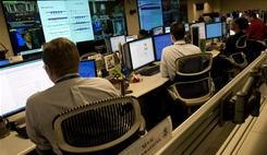 Analyists at the National Cybersecurity & Communications Integration Center prepare for Cyber Storm III during a media session at their headquarters in Arlington, Va., September 24, 2010. Cyber Storm III is NCCIC's capstone national-level cybersecurity exercise.
