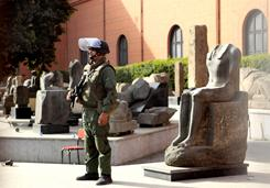An Egyptian army soldier stands guard near antiquities of the Egyptian museum in Cairo on Saturday.