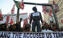 Pakistani activists shout slogans as they walk in the streets of Karachi with an effigy of an alleged U.S. consulate employee, Raymond Davis, during a protest rally Saturday.