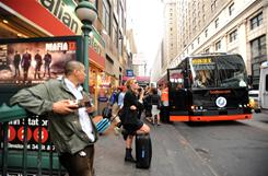 Passengers wait for a BoltBus at 33rd Street and Seventh Avenue in New York City.