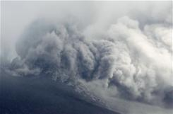 Volcanic ash rises from Mount Shinmoedake in the Kirishimna range on Japan's southernmost main island of Kyushu on Sunday, Jan. 30.