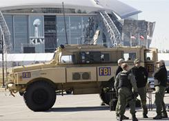 FBI agents -- in front of Cowboys Stadium in Arlington, Texas, on Jan. 21 --  often team up with federal, state and local law enforcement officials during Super Bowls to prevent terrorist attacks, ticket scams and other crimes, including high-priced prostitution.