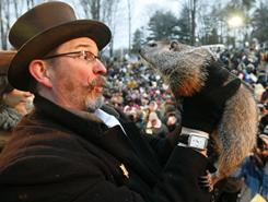 Punxsutawney Phil is held by Ben Hughes after emerging from his burrow on Gobblers Knob in Punxsutawney, Pa., on Feb. 2, 2010.