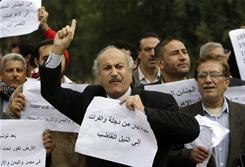 Iraqi protesters shout slogans against Egyptian President Hosni Mubarak on Sunday in Baghdad.