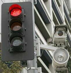 Opponents of red light cameras say the devices aren't designed to improve safety but simply to raise revenue for local governments.