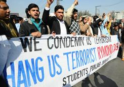 Pakistani students shout slogans during an anti-U.S. protest against Raymond Davis in Lahore on Tuesday. Davis is a U.S. government employee under investigation for killing two Pakistani men.