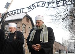 Muslim religious representatives walk through the entrance gate with the infamous German inscription 'Arbeit Macht Frei', (Work Sets You Free) in the former Nazi death camp Auschwitz-Birkenau, in Oswiecim, Poland.