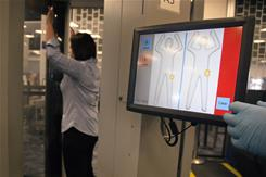 A Transportation Security Administration employee is screened using new software Tuesday in Las Vegas.