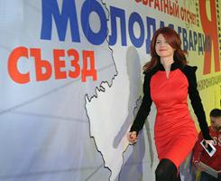 Former Russian spy Anna Chapman smiles as she arrives for a congress from a pro-Kremlin youth group Molodaya Gvardiya  (The Young Guard)  in Moscow, last Dec. 22. Chapman's spy ring used forged Irish passports.