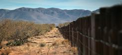 The U.S.-Mexico border fence stretches through the Sonoran Desert in Arizona. A program targeting illegal immigrants has been criticized.