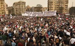 Protesters demand the ouster of Egyptian President Hosni Mubarak in central Cairo on Tuesday.