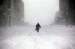 A man walks in the snow in Tulsa as blizzard conditions shut down much of the city on Tuesday.