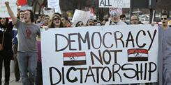 Protesters chant pro-democracy and anti-Hosni Mubarak slogans on Sunday in Dallas. Many of the protesters were from student-based organizations of the Dallas-Fort Worth area.