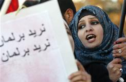 A woman joins protests Wednesday in Amman, Jordan.