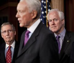 From left, Sens. Mitch McConnell, R-Ky., and John Cornyn, R-Texas, listen to Sen. Orrin Hatch, R-Utah, discuss the health care law Wednesday.