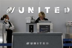 United Airlines officials check for flight information at O'Hare International airport in Chicago on Wednesday.