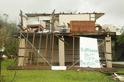 A sign marks a house destroyed by Cyclone Yasi. No deaths or serious injuries have been reported following the Category 5 storm.
