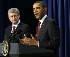 Canadian Prime Minister Stephen Harper and President Obama discuss border management on Friday in Washington.