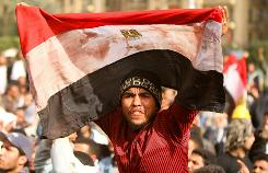 An anti-government protester waves a blood-stained Egyptian flag on Friday in Cairo's Tahrir Square.