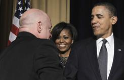 The Obamas greet astronaut Mark Kelly, husband of Rep. Gabrielle Giffords, D-Ariz., at the National Prayer Breakfast on Thursday in Washington.
