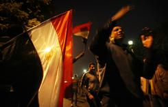 Anti-government protesters demanding the resignation of President Hosni Mubarak arrive at Cairo's Tahrir Square on Saturday.