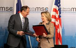 Secretary of State Hillary Clinton and Russian Foreign Minister Sergei Lavrov exchange documents formally bringing into force the landmark nuclear arms reduction pact START during the second day of the 47th Munich Security Conference at Hotel Bayerischer Hof on Saturday.