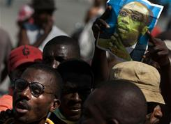 Protesters gather Monday to demand the ouster of Haitian President Rene Preval in Port-au-Prince. 