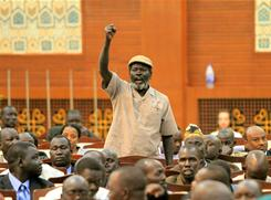 A man shouts as Southern Sudan's governing body declares the final results of the independence referendum on Monday.