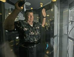 A passenger prepares for a full-body scan at Ronald Reagan Washington National Airport. Scanner use has sparked concerns about radiation safety.