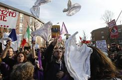 Demonstrators throw women's underwear in the air during a protest Sunday outside Italian Premier Silvio Berlusconi's residence in Arcore, Italy.