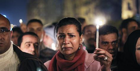 An anti-government protester weeps on Wednesday for those killed during the uprising in Tahrir Square.