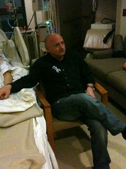 Mark Kelly watches the State of the Union Address with his wife, Rep. Gabrielle Giffords, in her hospital room Jan. 25 in Houston.