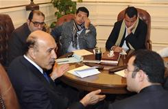 Omar Suleiman, left, met with protesters' representatives in Cairo earlier this week.