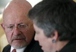 Director of National Intelligence James Clapper and Homeland Security Secretary Janet Napolitano talk before a meeting earlier this month.