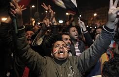 Protesters react to Egyptian President Hosni Mubarak's televised statement in Cairo's Tahrir Square Thursday night.
