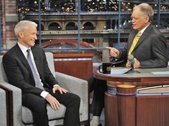 "In this photo released by CBS, CNN news and anchor person, Anderson Cooper, left, discusses the problems he had on the ground while covering the unrest in Egypt with host David Letterman on the set of the ""Late Show with David Letterman"" on Wednesday."