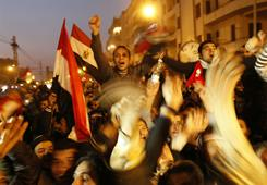Egyptian anti-government protesters celebrate at Cairo's Tahrir Square after President Hosni Mubarak stepped down on Feb. 11.