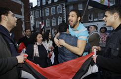 Pro-democracy supporters react to the resignation of President Hosni Mubarak outside the Egyptian Embassy in London on Friday.