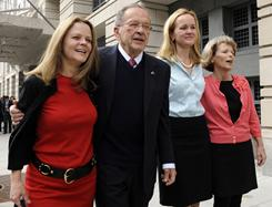 In this April 7, 2009 file photo, former Alaska Sen. Ted Stevens stands with his daughters, from left, Beth Stevens, Lily Stevens and Susan Covich as he leaves federal court in Washington.